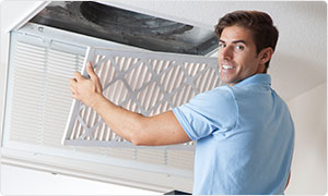 man with air conditioning filter